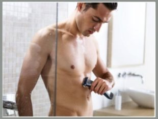 Man using a body groomer on his chest
