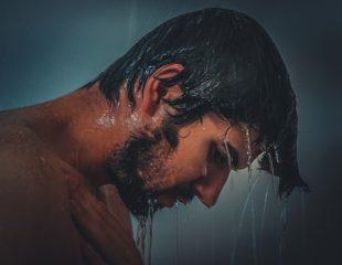 man taking hot shower before shaving.